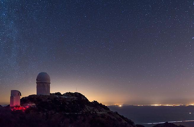 The Mayall observatory at Kitt Peak overlooks Tucson, Arizona on a clear starry night; Shutterstock ID 128928842; Project/Title: Fodors.com; Destination: Arizona; Downloader: Fodor's Travel