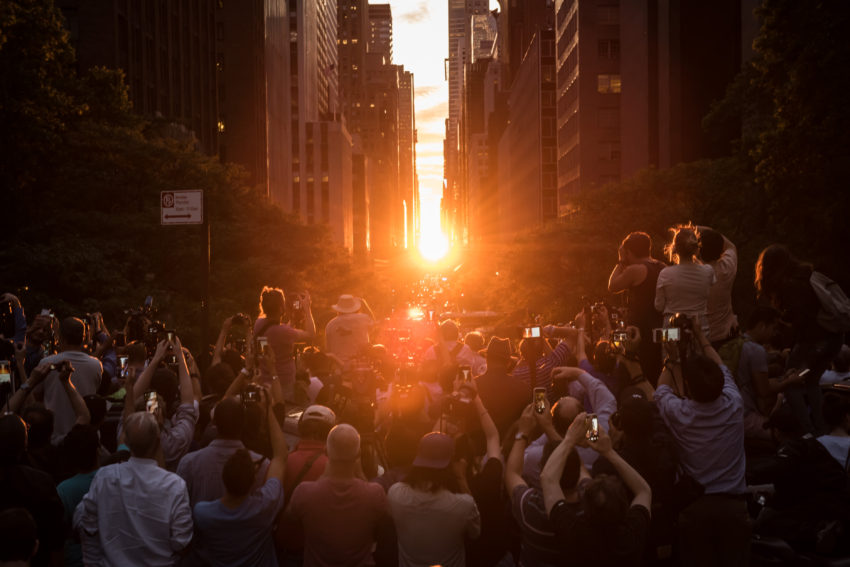 Crowds gather on the Tudor City Overpass to witness Manhattanhenge on Monday, July 12, 2016. The local solar event occurs when the setting sun perfectly aligns with the east-west Manhattan street grid. Michael Appleton/Mayoral Photography Office